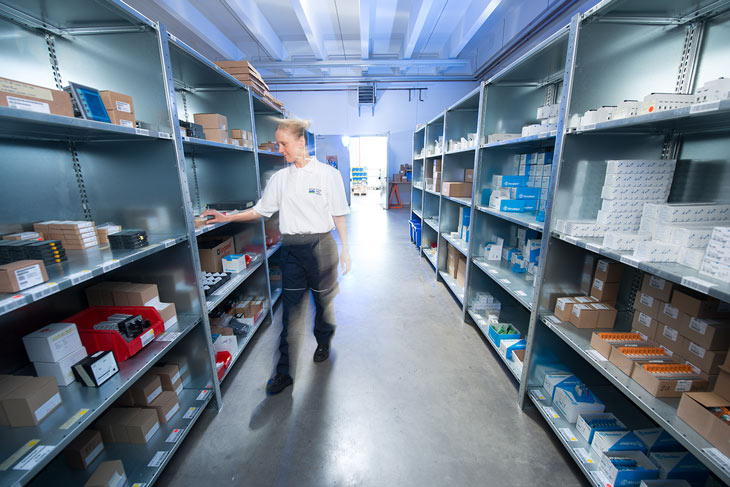 HPS employee sorts things in the parts warehouse